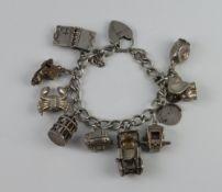 A silver charm bracelet 57 grams