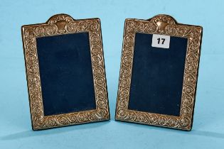 A PAIR OF ELIZABETH II FOLIATE EMBOSSED PHOTO FRAMES of arched rectangular form, maker: RC, 1993,