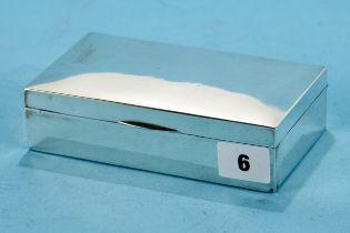 A GEORGE V RECTANGULAR SILVER CIGARETTE BOX, maker: PJE, Birmingham 1922, 6 ins x 3 1/2 ins.