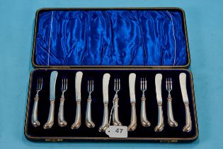 A SET OF SIX LATE VICTORIAN SILVER PISTOL-HANDLED TEA KNIVES AND FORKS, plated blades, maker GH,