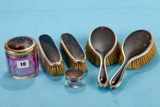 A PAIR OF GEORGE V SILVER AND TORTOISESHELL BACKED HAIR BRUSHES, a pair of matching CLOTHES BRUSHES,