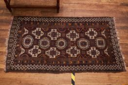 A 20TH CENTURY HAMADAN RUG, central panel on a cream ground with three outer guard stripes, 60 ins x