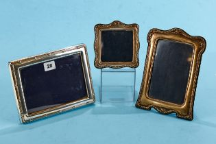 AN ELIZABETH II RECTANGULAR SILVER PHOTO FRAME with reeded border, maker: RC, stamped 925, 8 1/2 ins