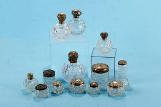 SEVEN SILVER LIDDED TOILET JARS and five various silver topped SCENT BOTTLES, mostly a.f. (12)