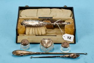 AN EDWARDIAN SILVER HAIR BRUSH AND COMB SET with embossed decoration maker: L&S, Birmingham 1905