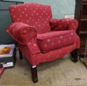 A upholstered armchair with fleur de lys decoration Please Note - we do not make reference to the