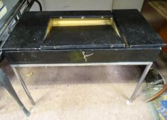 "A retro desk with central lifting top and a chromed base. Approx. 37"" wide Please Note - we do not"