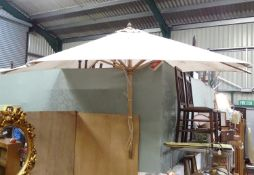 A large parasol. Approx. 7ft wide Please Note - we do not make reference to the condition of lots