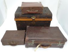 "A painted tin trunk, with a suitcase and two attache cases/ The largest approx. 25"" wide (4)"