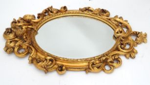 "A gilt mirror with cherub detail. Approx. 35 1/2"" long Please Note - we do not make reference to the"
