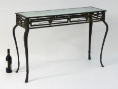 Vintage Retro: a powder coated hall table with plate glass top, ornate cabriole legs and frieze