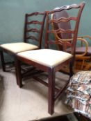 "Two 19thC mahogany ladder back chairs. Approx. 36 1/2"" tall (2) Please Note - we do not make"