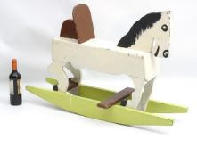 Rocking horse : a scratch built and painted wooden rocking horse on bows with brown painted back and