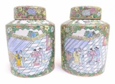 A pair of Chinese jars and covers profusely decorated with flowers and foliage, with two lobed