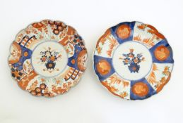 Two Japanese plates decorated in the Imari pattern with central floral design. The outer with floral