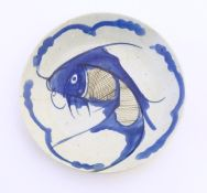 An Oriental blue and white plate with hand painted carp fish decoration. Character marks under.