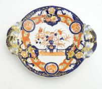 An Ashworth's Ironstone China twin handled plate decorated in the Imari palette with floral