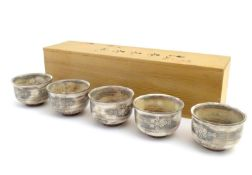 A set of five Japanese chawan / tea bowls decorated with flowers in the Mishima style. Impressed