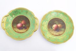 A Coalport twin handled dish and plate with a green and gilt ground with hand painted central