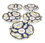 Five 19thC Royal Worcester dessert plates with scalloped rims decorated with hand painted with
