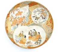 A Japanese satsuma charger with hand painted panelled decoration depicting stylised peony flowers, a