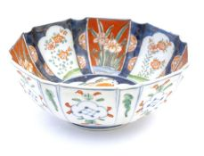 A Japanese octagonal bowl in the Imari palette the centre decorated with ducks in a pond, the
