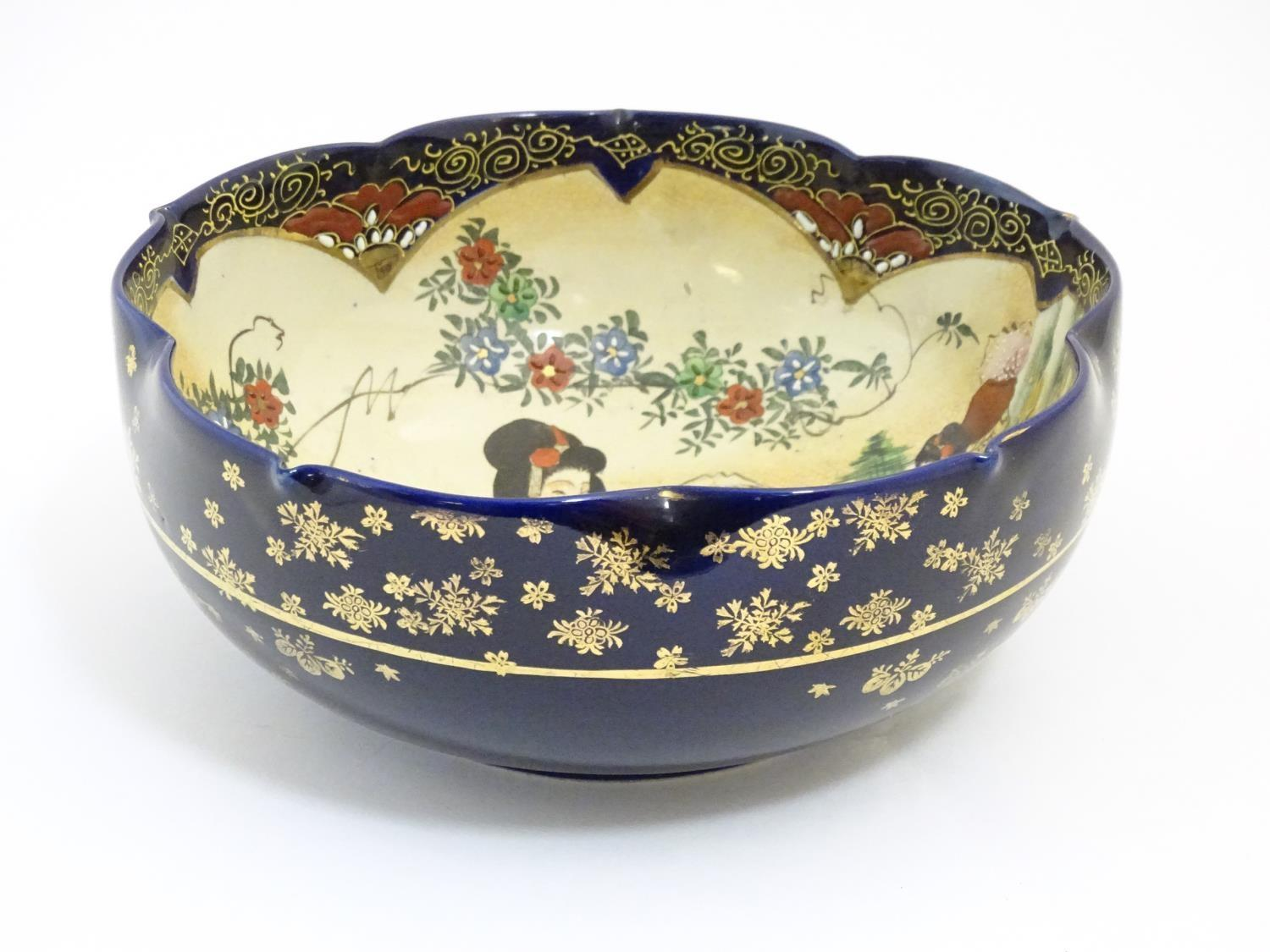 A Japanese export bowl with a lobed rim, decorated with Geisha girls with fans and flowers in a - Image 5 of 7