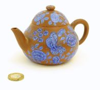 A Chinese Yixing clay teapot with blue flower and butterfly decoration. Incised character marks