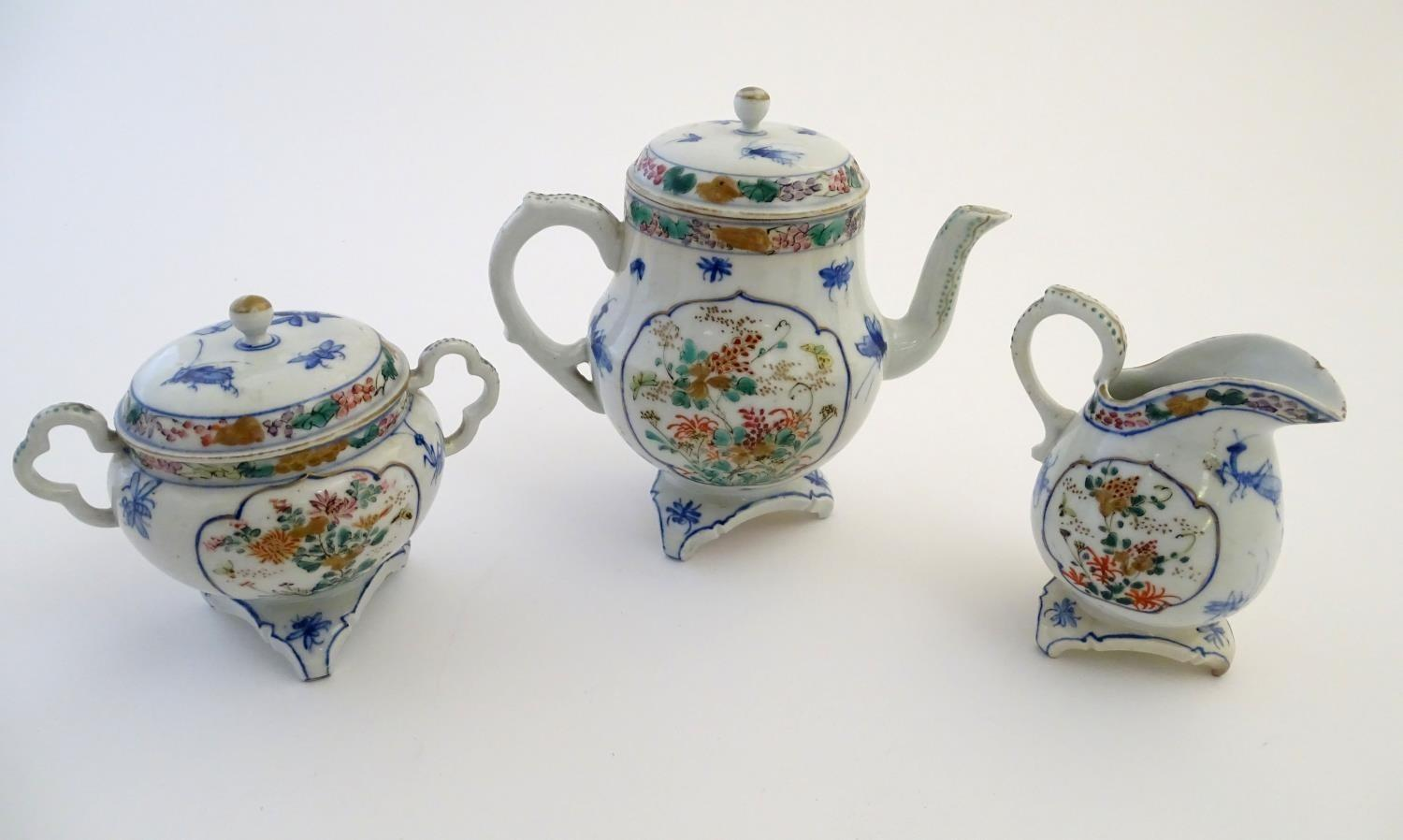 A Japanese teapot, twin handled sugar bowl and milk jug decorated with hand painted insects and - Image 8 of 8