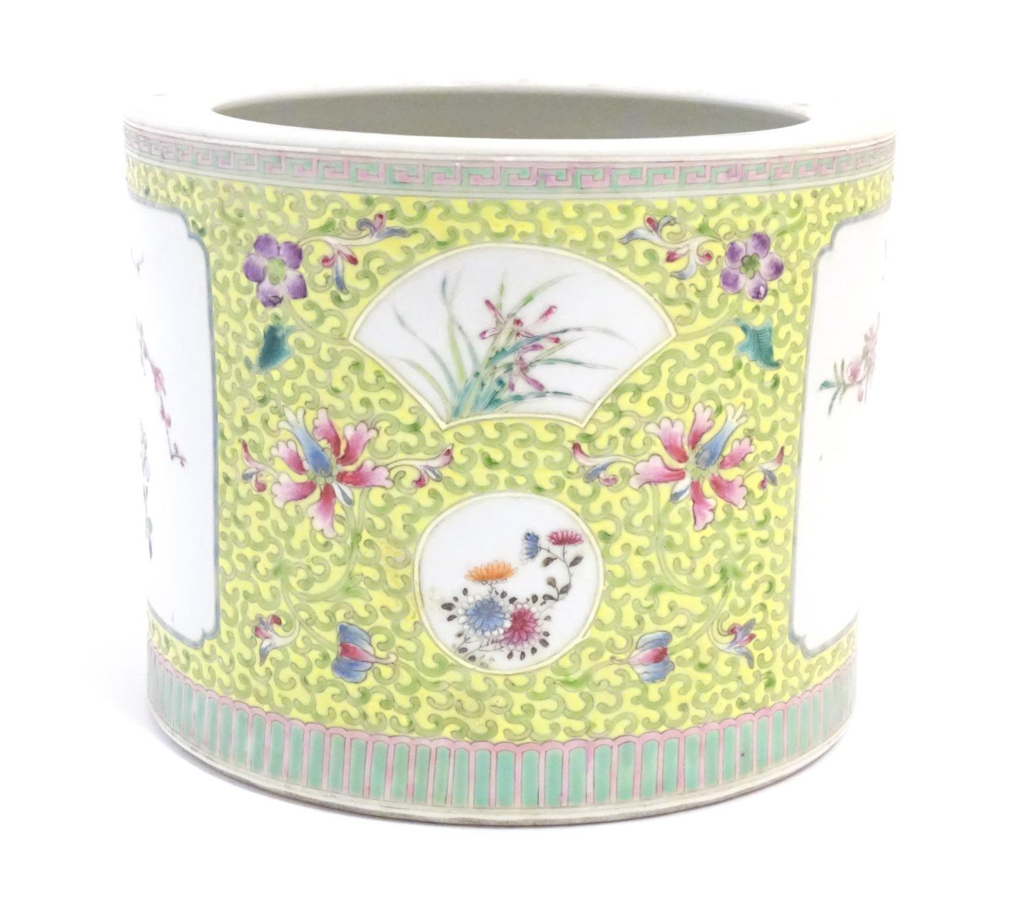 A Chinese famille jaune planter with a floral and foliate ground and panelled decoration with - Image 2 of 7