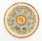 An Oriental plate in the Kutani palette the centre with stylised dragon detail, with banded motif