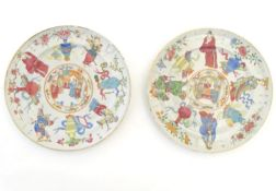 A pair of Chinese famille rose plates decorated with warrior figures / heroes with auspicious