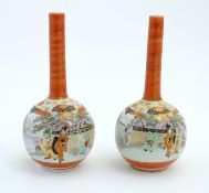 Two Japanese Kutani bottle vases decorated figures in a landscape scenes. Character marks under.