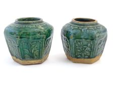 Two Chinese hexagonal Shiwan ginger jars / vases with moulded floral and foliate detail with a