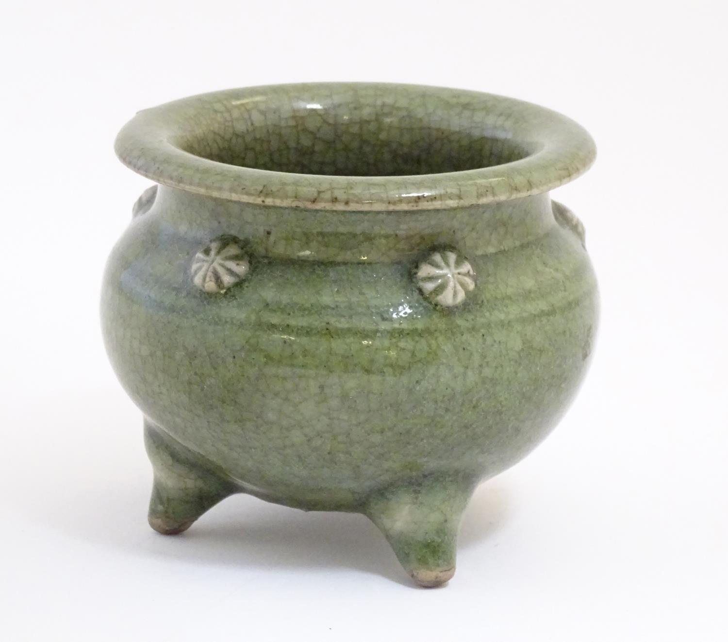 """A Chinese three footed censor with a crackle glaze and floral roundels in relief. Approx. 3 1/4"""" - Image 3 of 7"""