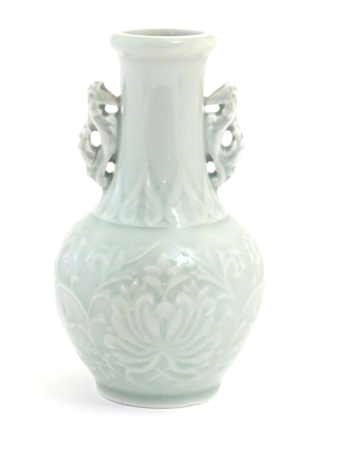 A Chinese celadon green baluster vase with twin handles and stylised foliate design. Approx. 6 1/ - Image 3 of 6