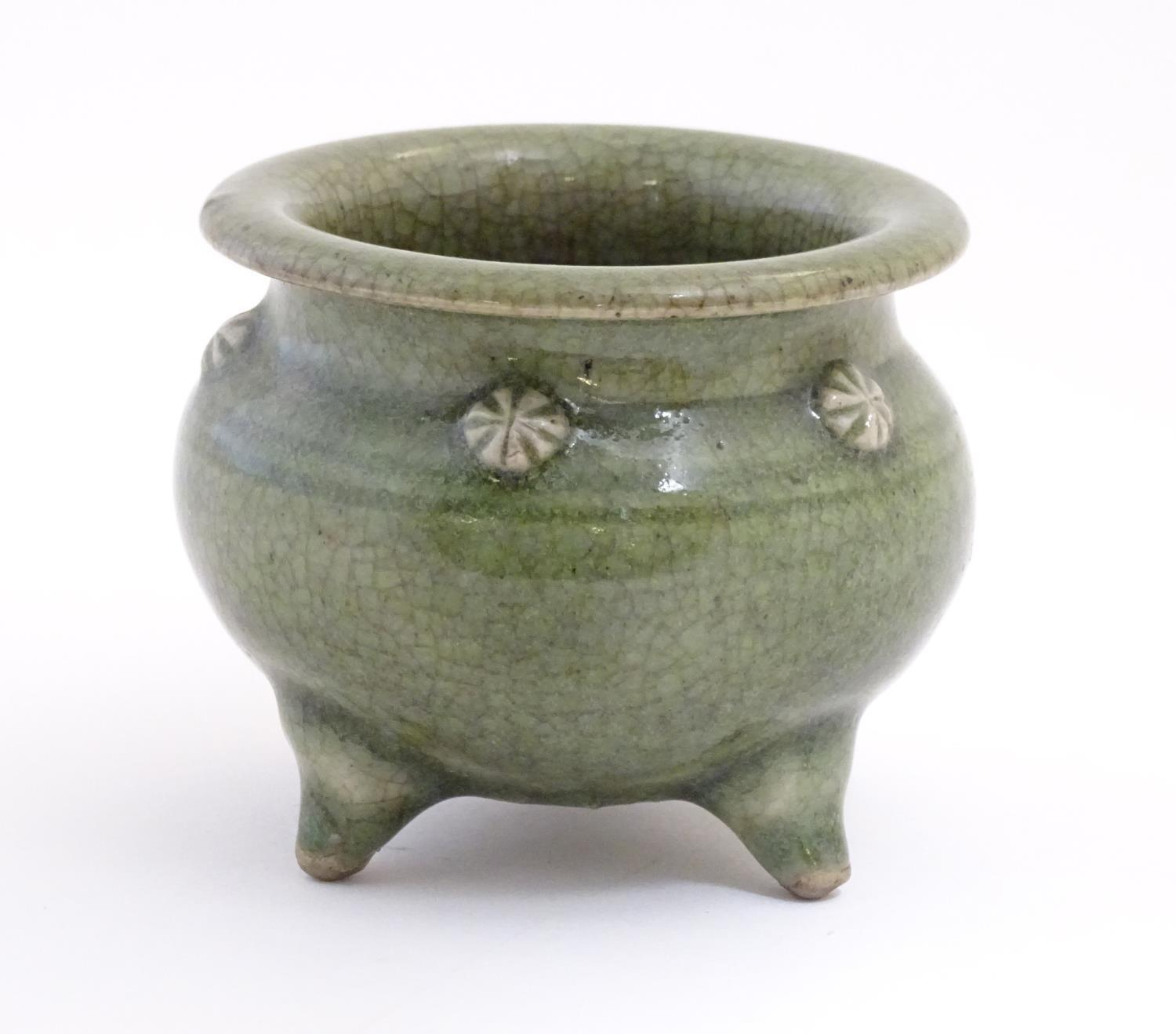 """A Chinese three footed censor with a crackle glaze and floral roundels in relief. Approx. 3 1/4"""" - Image 7 of 7"""
