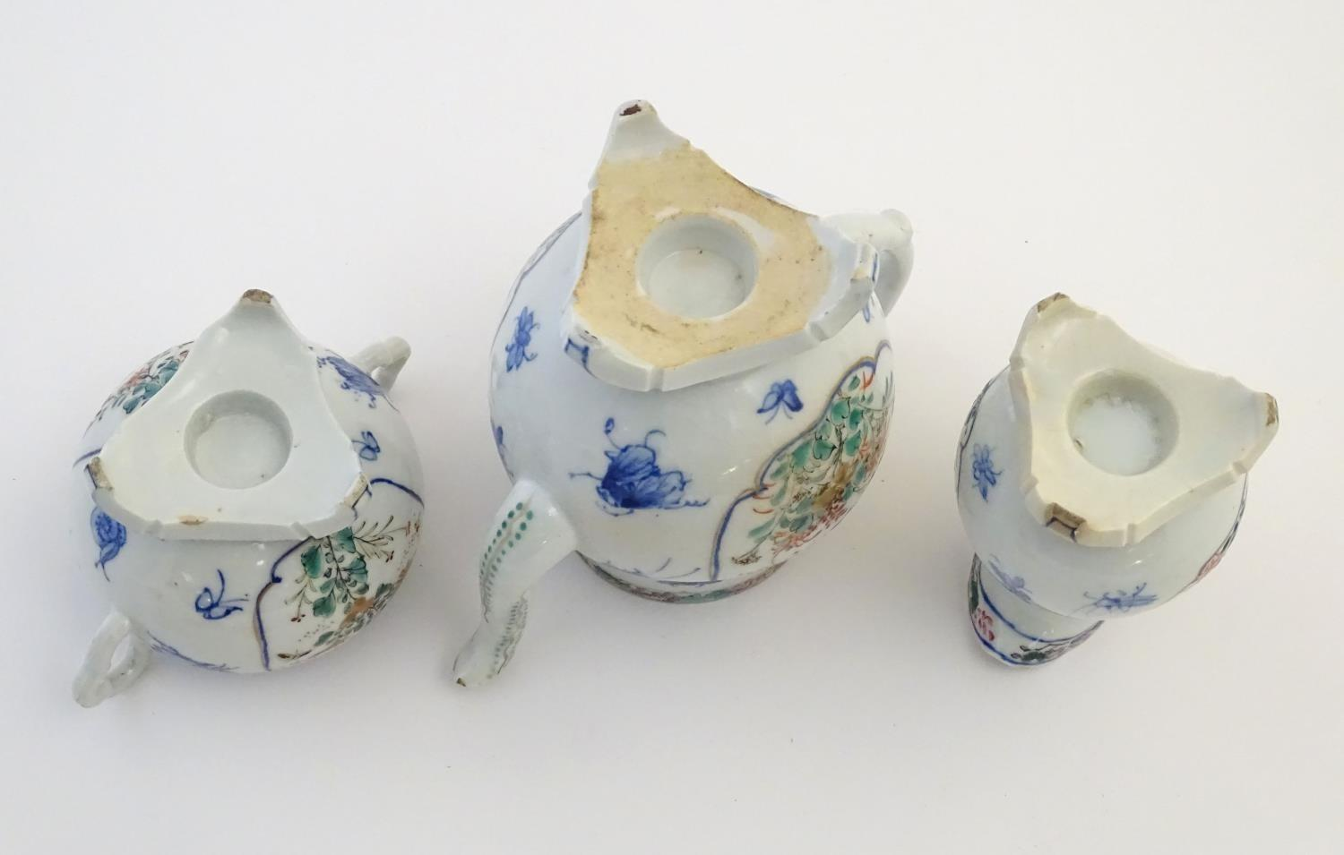 A Japanese teapot, twin handled sugar bowl and milk jug decorated with hand painted insects and - Image 2 of 8