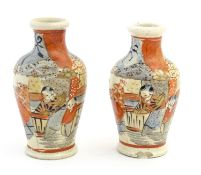 A pair of Japanese Satsuma vases of small proportion decorated with stylised figures. Character