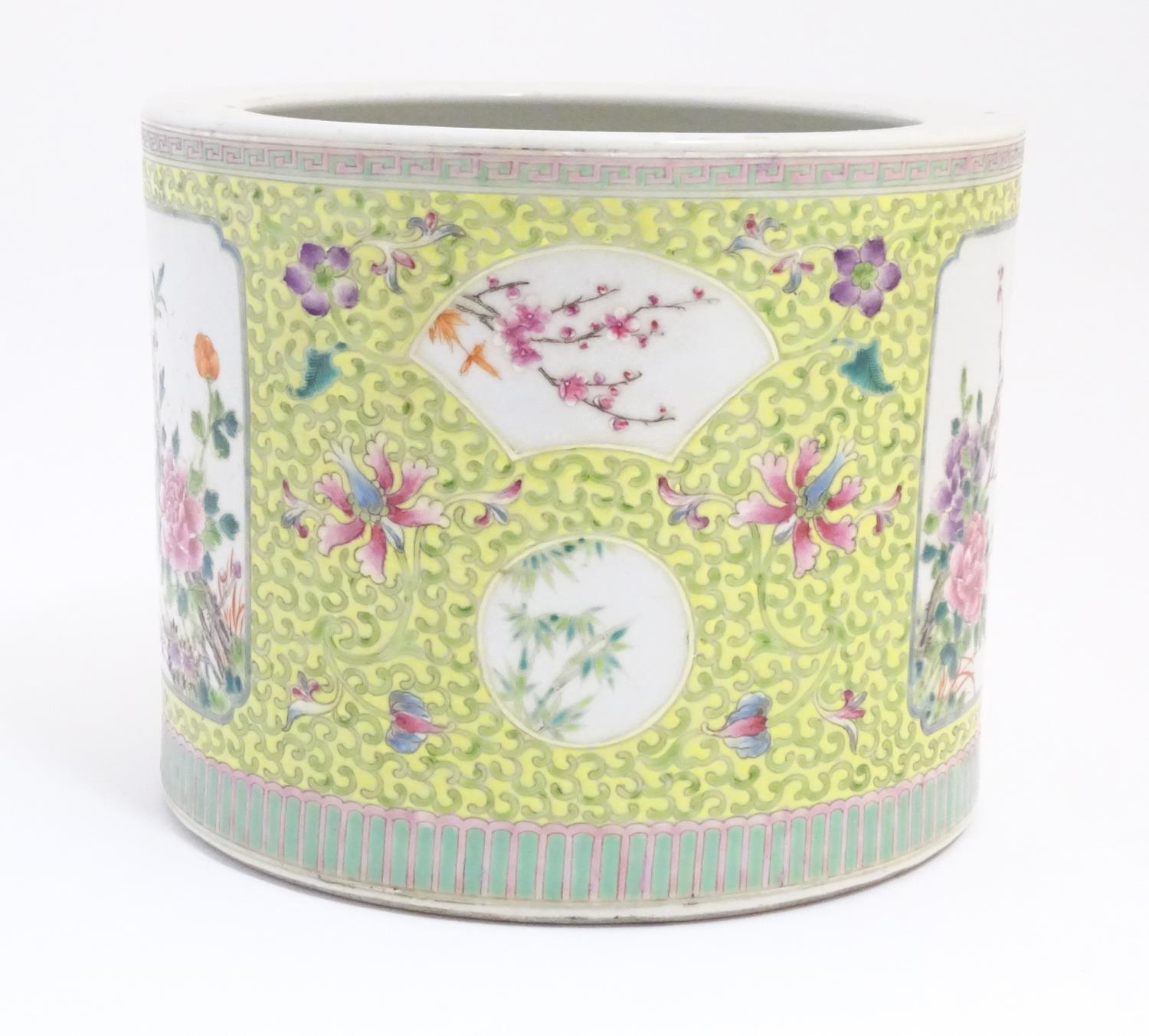 A Chinese famille jaune planter with a floral and foliate ground and panelled decoration with - Image 5 of 7
