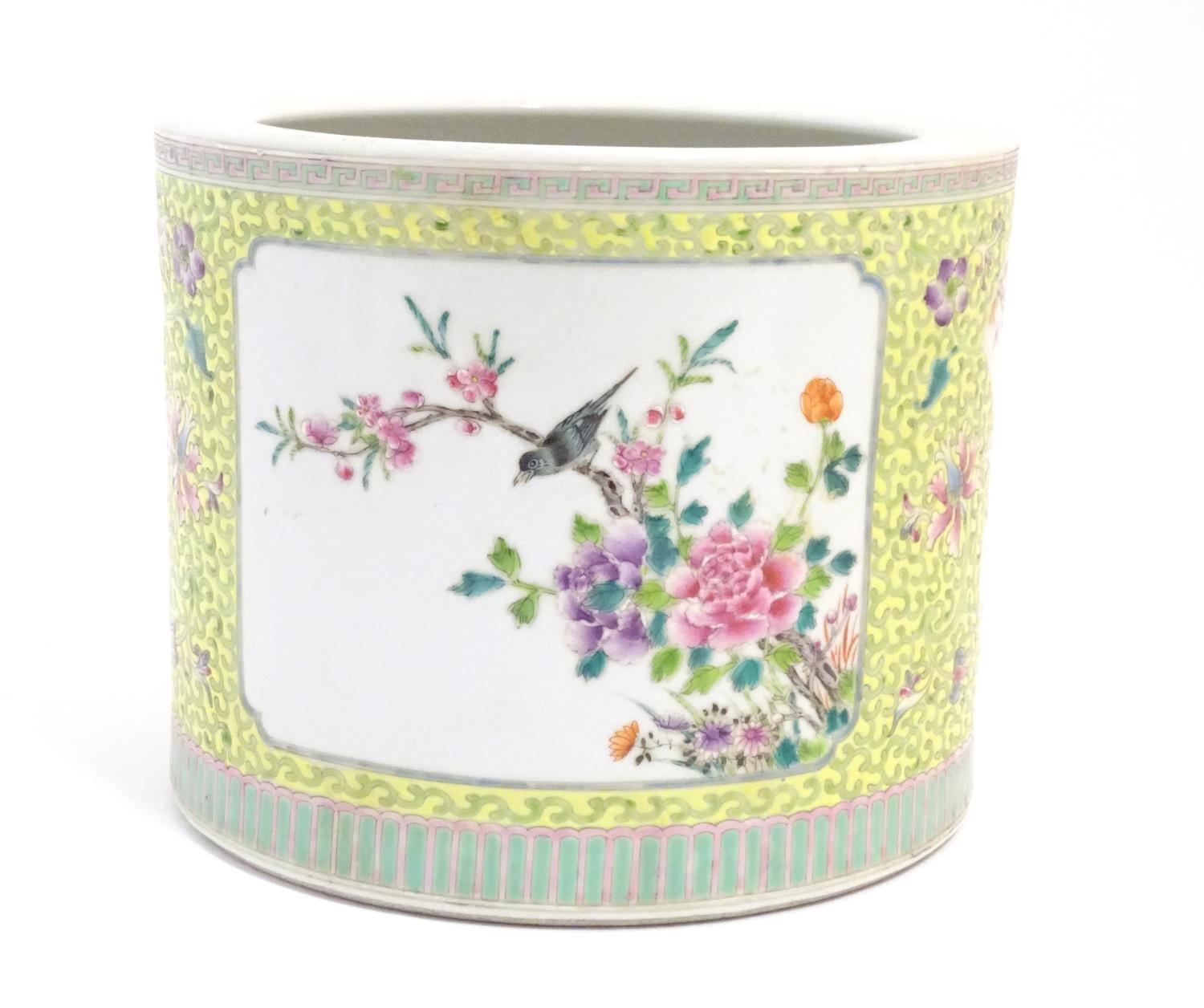 A Chinese famille jaune planter with a floral and foliate ground and panelled decoration with - Image 3 of 7