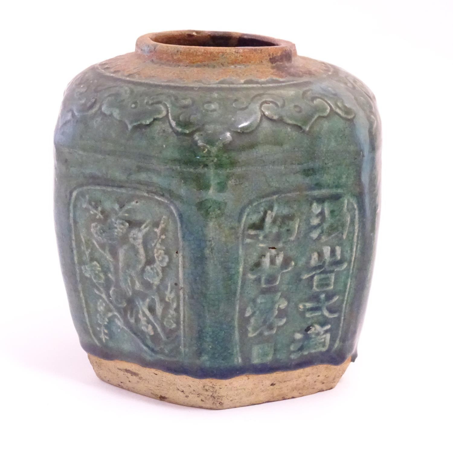 A Chinese hexagonal Shiwan ginger jar / vase with moulded floral, foliate, bird and script detail - Image 3 of 5