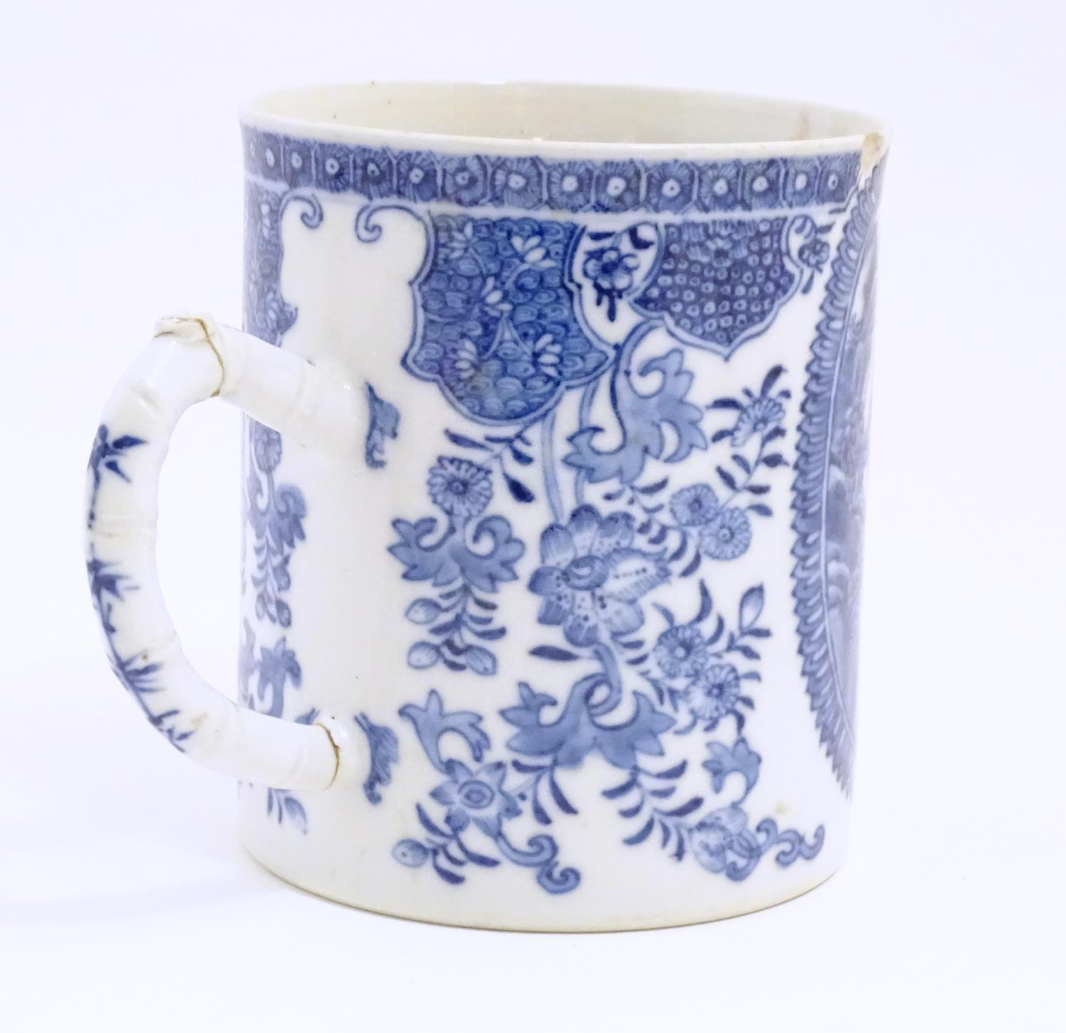 A Chinese blue and white export mug depicting a landscape scene with pagodas, with floral and - Image 3 of 6