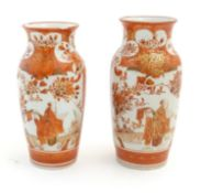 Two Japanese Kutani vases depicting scholars in a landscape, floral and foliate designs and gilt