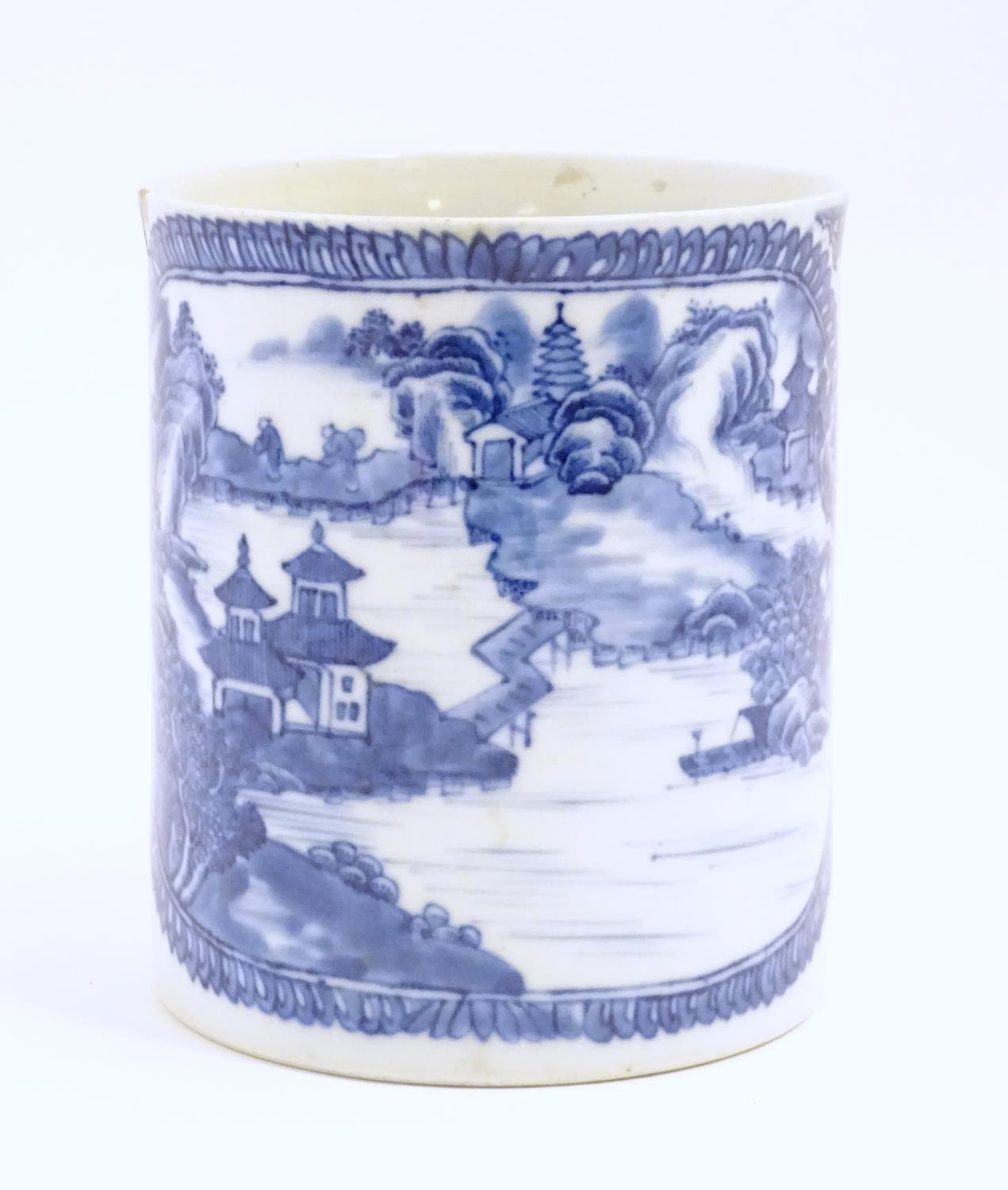 A Chinese blue and white export mug depicting a landscape scene with pagodas, with floral and - Image 5 of 6
