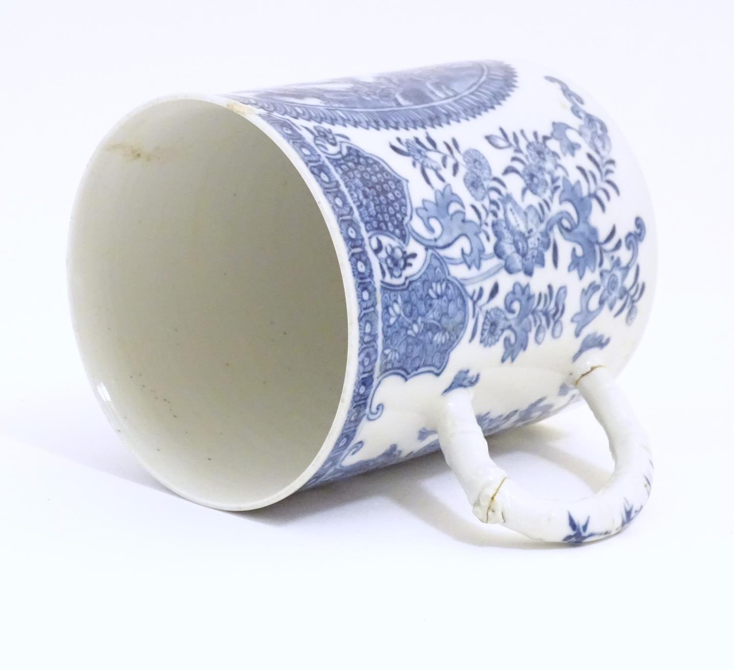 A Chinese blue and white export mug depicting a landscape scene with pagodas, with floral and - Image 6 of 6
