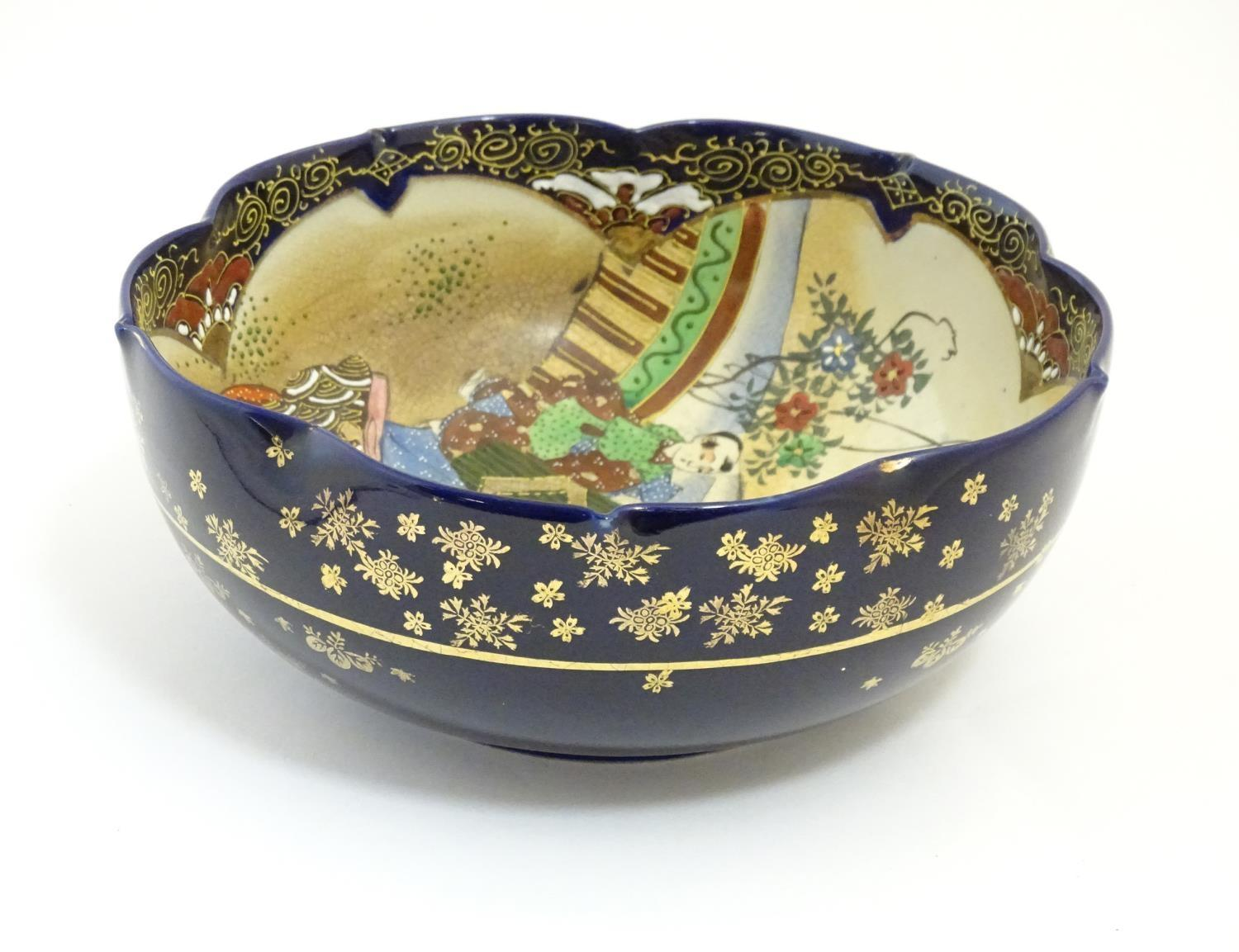 A Japanese export bowl with a lobed rim, decorated with Geisha girls with fans and flowers in a - Image 4 of 7