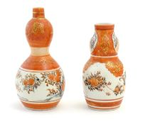 Two Japanese Kutani vases with floral, foliate and bird detail with gilt highlights. Character marks