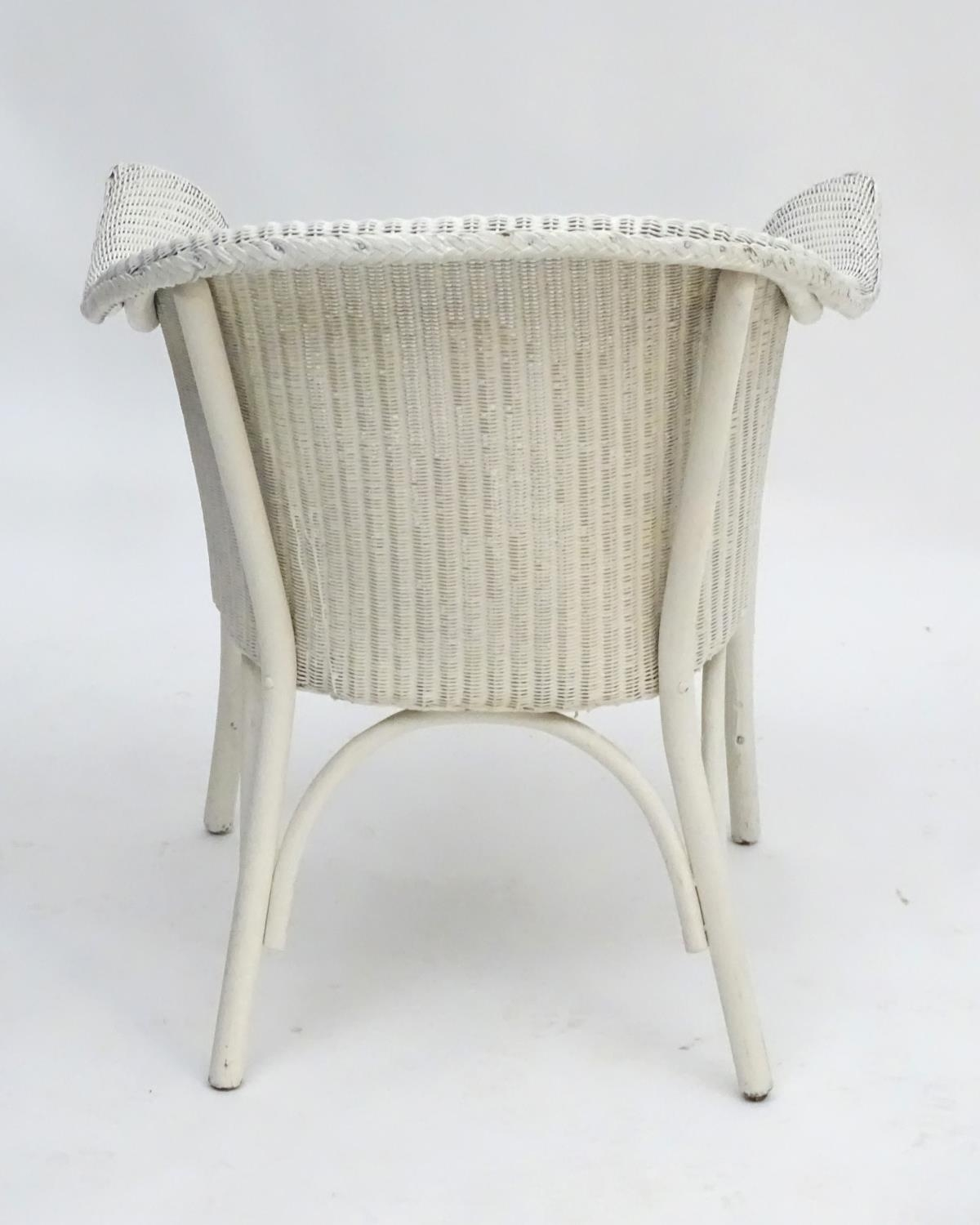 An early 20thC LLoyd loom armchair with a white painted bentwood frame. Bearing label to underneath. - Image 5 of 6
