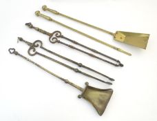 An assortment of 19thC and later cast brass fire irons / fire tools, comprising an Art Nouveau